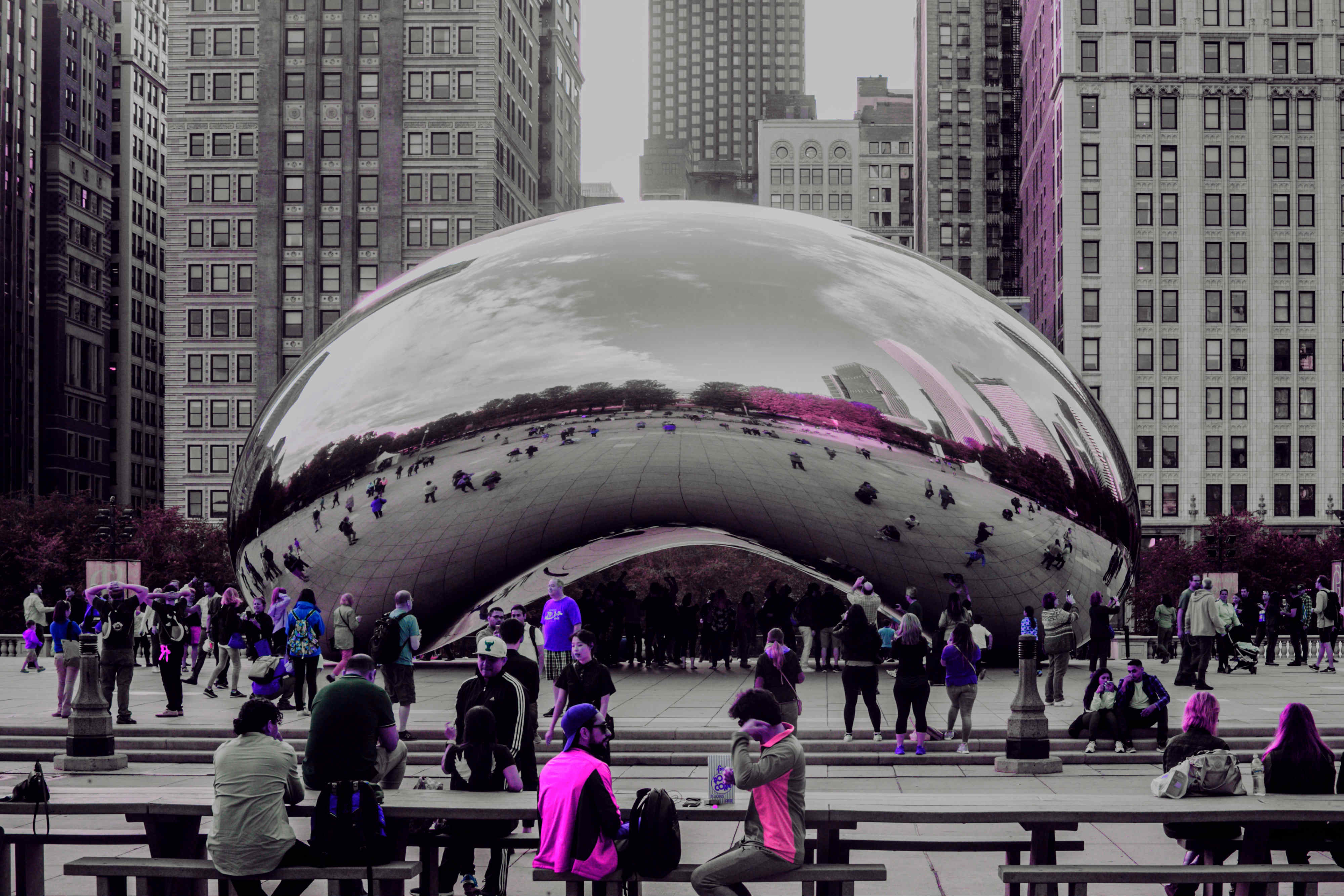 image of people playing around the bean of Chicago.